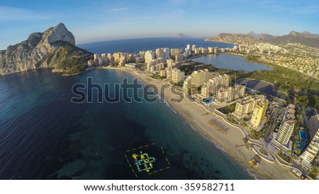 Aerial view of sunny morning on the beach of Calpe, Calp. Penon de Ifach also on the photo.