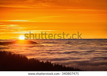 Aerial view of Sunrise over mountain and fog