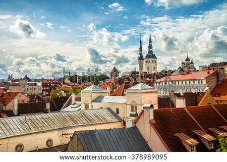Aerial view of Tallinn old town, Estonia. Red rooftops with cloudy sky. Popular landmark in Baltic region - stock photo