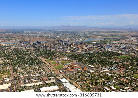 Aerial view of Tempe, Arizona looking to the Northeast with the McDowell Mountains in the distance - stock photo