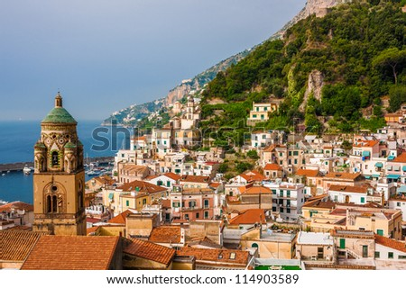 Aerial view of the Amalfi city with bell tower in front, Italy - stock photo
