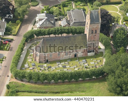 Aerial view of the ancient church Agneskerk and cemetery in Goutum, Friesland, Netherlands.