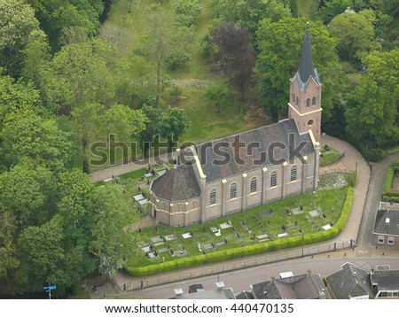 Aerial view of the ancient church and cemetery in IJsbrechtum, Friesland, Netherlands. - stock photo