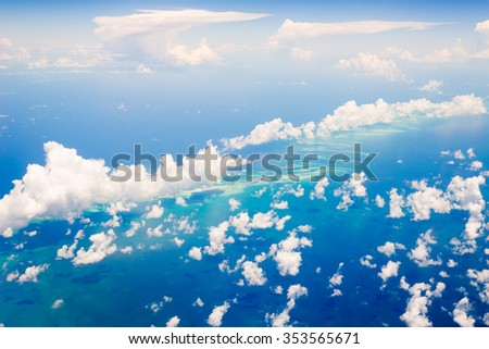 Aerial view of the Bahamas, stunning islands, sand bars and coral reefs with turquoise sea, shot from aeroplane. - stock photo