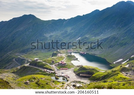 Aerial view of the Balea lake and Fagaras mountains in Romania - stock photo