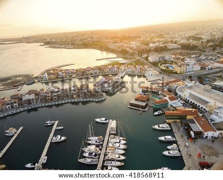 Aerial view of the beautiful Marina in Limassol city in Cyprus,beach,boats,piers,villas and commercial area.A modern,high end,newly developed space with docked yachts and for a waterfront promenade.  - stock photo
