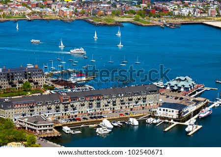 Aerial view of the Boston harbor and waterfront buildings. Colorful, bright image - stock photo