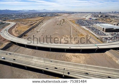 Aerial view of the bridges of State Routes 143 and 153 over the dry Salt River bed in Phoenix, Arizona - stock photo