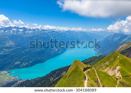 Aerial view of the Brienz lake and the alps from Brienzer Rothorn on Bernese Oberland near the famous tourism region of Interlaken, Jungfrau region, Switzerland. - stock photo