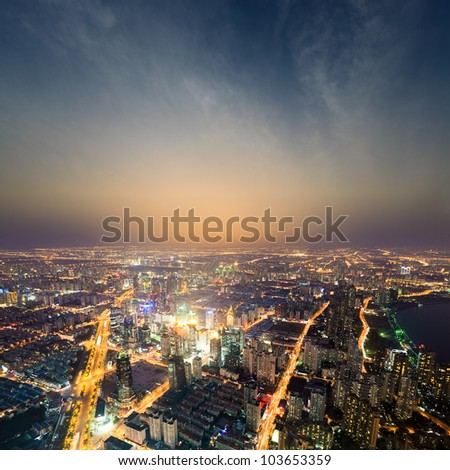 aerial view of the bright lights of the metropolis at night in shanghai - stock photo