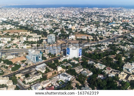 Aerial view of the city of Dakar, Senegal, showing the densely packed buildings and a highway - stock photo