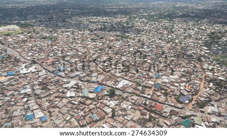 Aerial view of the city of Dar Es Salaam  showing the densely packed houses and  buildings - stock photo