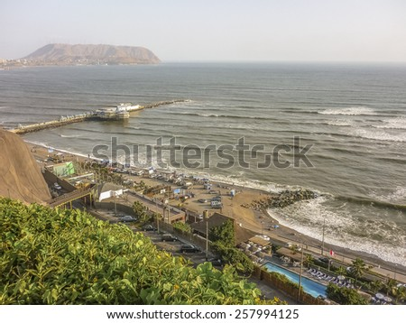 Aerial view of the city of Lima at daytime with the pacific ocean as the main subject. - stock photo