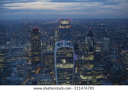 Aerial view of the city of London at dusk. With the financial district in the foreground. - stock photo