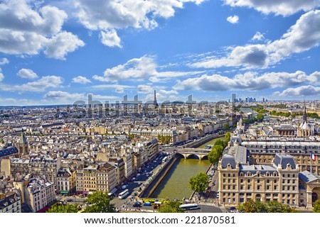 Aerial view of the city of Paris, on the roof of homes, the river Seine and the Eiffel Tower - stock photo