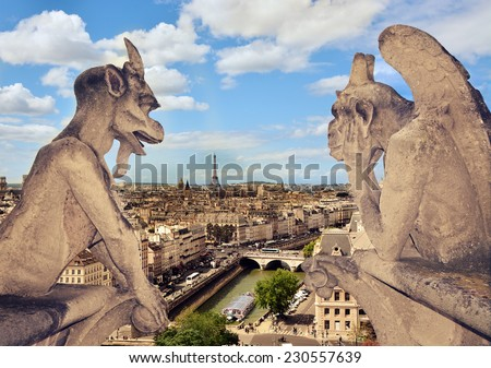 Aerial view of the city of Paris, rooftops and the Eiffel Tower from the gallery of chimeras Notre Dame de Paris - stock photo