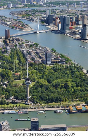 Aerial view of the city of Rotterdam with Euromast, Erasmus bridge, railway bridge and building De Rotterdam, the Netherlands. - stock photo