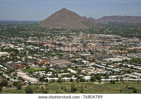Aerial view of the City of Scottsdale Arizona with Camelback Mountain in the distance - stock photo