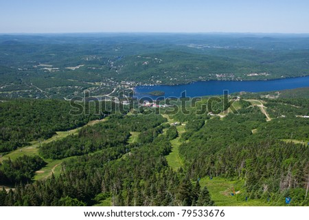 Aerial View of the City of Tremblant in the middle, and  the background the Mountains of Laurentides Quebec,Canada - stock photo