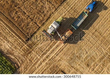 aerial view of the combine on harvest field in Poland. - stock photo
