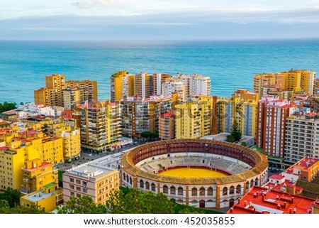 aerial view of the corrida building in the spanish city malaga during sunset - stock photo