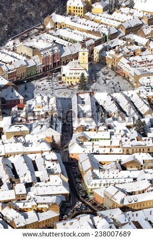 Aerial view of the Counsel House and Square in old Brasov city, Romania - stock photo