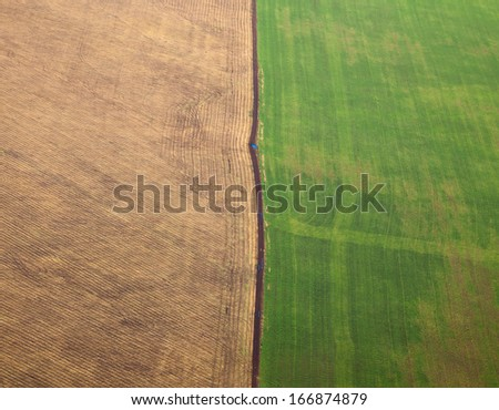 Aerial view of the countryside with fields of crops.  - stock photo