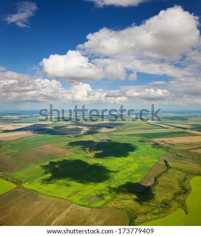 Aerial view of the countryside with fields of crops and pine forests in summer. - stock photo