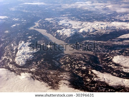 Aerial view of the distant scandinavian fjord, mountains and clouds