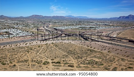 Aerial view of the East Mesa Interchange of Loop 202 and the Superstition Freeway - stock photo
