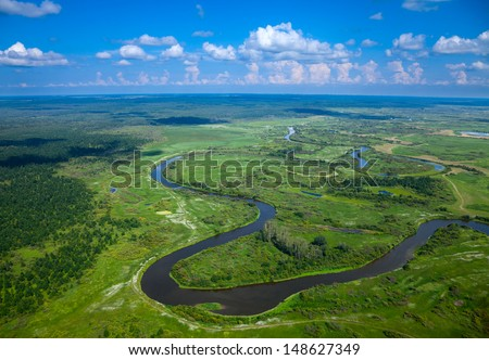 Aerial view of the forest river in summer. - stock photo