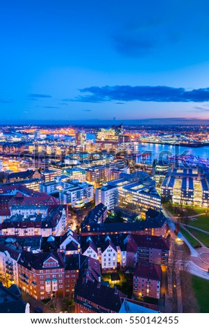 Aerial view of the harbor district and downtown Hamburg, Germany, at dusk .