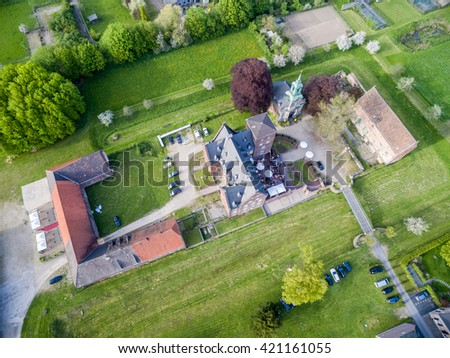 Aerial view of the historic buildings of castle Diersfordt in Wesel, Germany