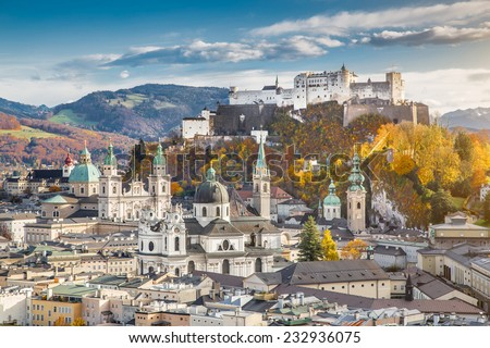 Aerial view of the historic city of Salzburg with Hohensalzburg Fortress in beautiful evening light in fall, Salzburger Land, Austria - stock photo