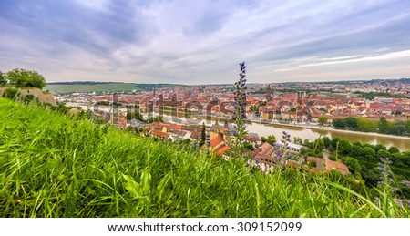 Aerial view of the historic city of Wurzburg in mystical evening light, region of Franconia, Northern Bavaria, Germany - stock photo