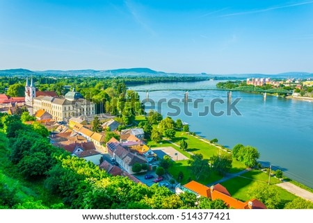 aerial view of the hungarian city esztergom, slovakian city sturovo and danube river including spires of the saint ignac church