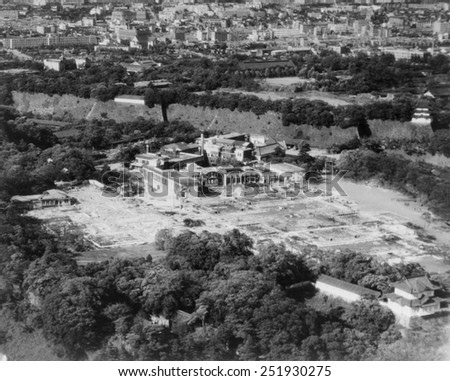 Aerial view of the Imperial Palace in Tokyo, after being bombed by U.S. airplanes. The damaged buildings are outside the walls of the major palace complex. 1945. World War 2. - stock photo