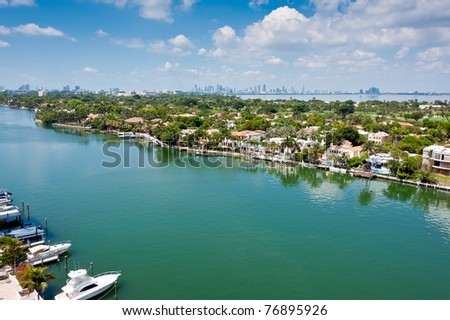 Aerial view of the Indian Creek Canal in Miami Beach with Downtown Miami skyline in the back. - stock photo