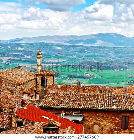 Aerial View of the Italian Medieval City  and Surrounding Tuscan Landscape  - stock photo