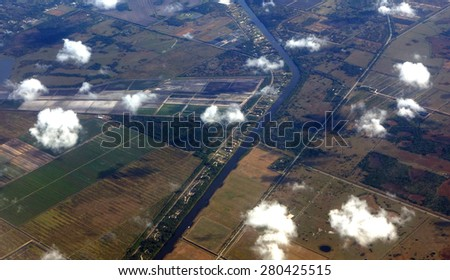 Aerial view of the Kissimmee River which was straightened by the Army Corps of Engineers, which flows into Lake Okeechobee. - stock photo