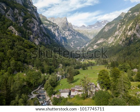 Aerial view of the Mello Valley, Val di Mello, a green valley surrounded by granite mountains and forest trees, renamed the little italian Yosemite Valley. River and lakes. Italy