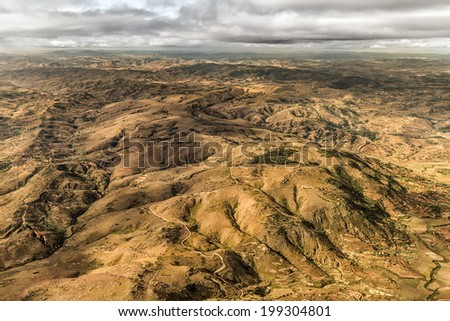 Aerial view of the of the mountainous terrain of the highland areas of Madagascar - stock photo