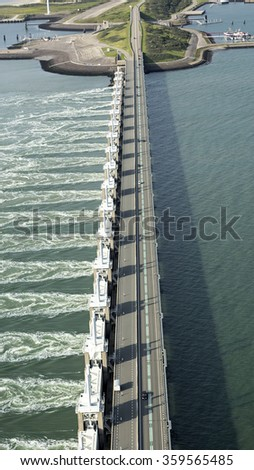 Aerial view of the Oosterscheldekering, a storm surge barrier which is part of the delta works to protect Holland from high sea level - stock photo