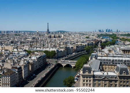 Aerial view of the Paris from the top of the Notre dame de Paris.This photograph shows the Eiffel Tower,Seine river,business district,streets,bridge and ancient town. - stock photo