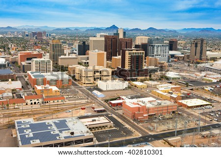 Aerial view of the Phoenix, Arizona skyline against the day's blue sky.