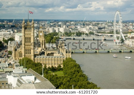 Aerial view of the River Thames at Westminster with the Houses of Parliament on the right hand side and the bridges of Westminster, Hungerford and Waterloo. - stock photo