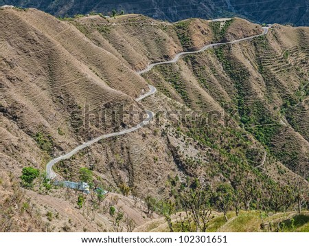 Aerial view of the road and nature on the way to of remote Himalayan region in Chamba district Himachal Pradesh India. - stock photo
