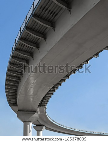 Aerial view of the road span with clear sky background - stock photo