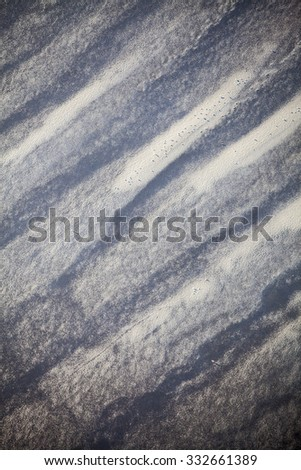 Aerial view of the shore with shapes, lines and patterns formed by the waves on the sand, Ameland islad, Friesland, The Netherlands - stock photo