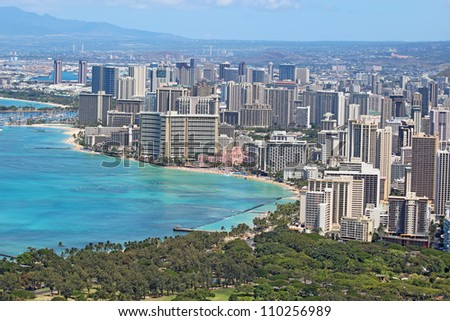Aerial view of the skyline of Honolulu, Oahu, Hawaii, showing the downtown and hotels around Waikiki Beach and other areas - stock photo